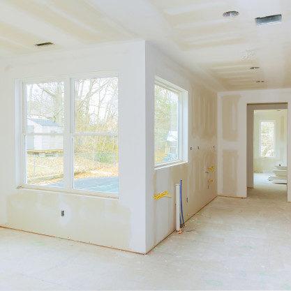 construccion-interior-proyecto-vivienda-paneles-yeso-instalados-parcheados-pintura-aplicada_73110-1288